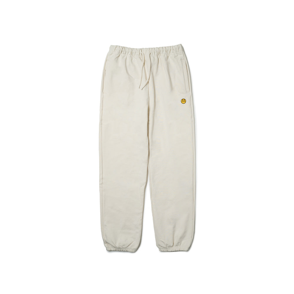 UNSMILE SWEAT PANTS CREAM